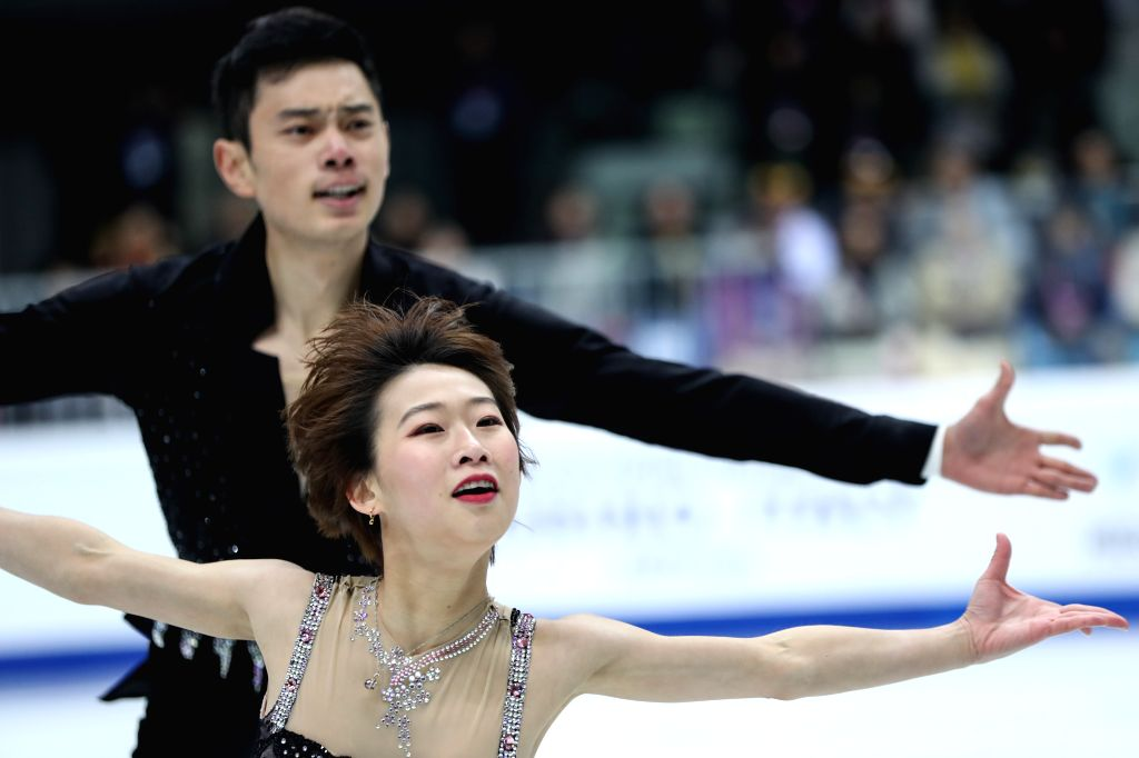 TURIN, Dec. 6, 2019 - Peng Cheng (Front)/Jin Yang of China compete during the pairs short program at the ISU Grand Prix of Figure Skating Final 2019 in Turin, Italy, Dec. 5, 2019.