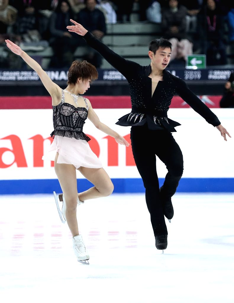 TURIN, Dec. 6, 2019 - Peng Cheng (L)/Jin Yang of China compete during the pairs short program at the ISU Grand Prix of Figure Skating Final 2019 in Turin, Italy, Dec. 5, 2019.