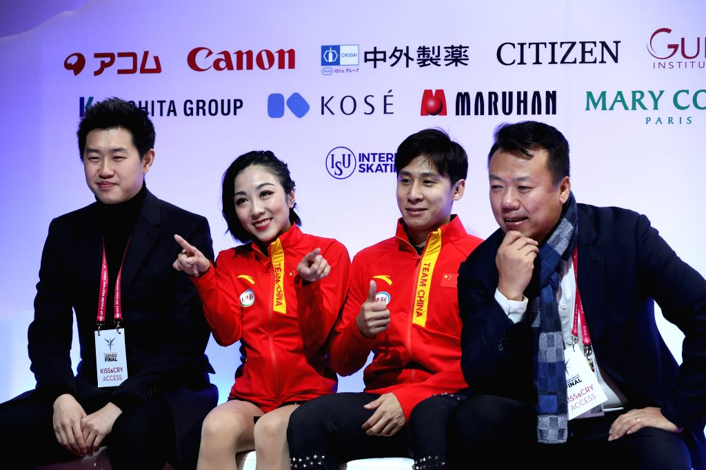 TURIN, Dec. 6, 2019 - Sui Wenjing (2nd L)/Han Cong (2nd R) of China wait for the score after the pairs short program at the ISU Grand Prix of Figure Skating Final 2019 in Turin, Italy, Dec. 5, 2019.