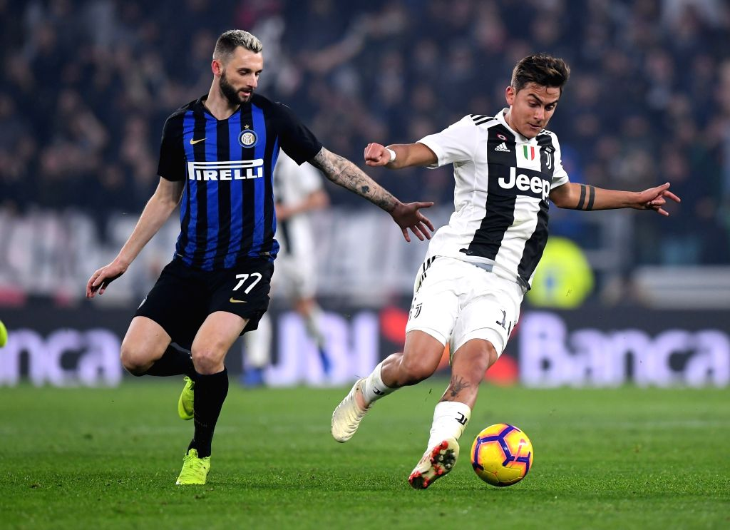TURIN, Dec. 8, 2018 - FC Juventus' Paulo Dybala (R) vies with Inter Milan's Marcelo Brozovic during the Serie A soccer match between FC Juventus and Inter Milan in Turin, Italy, Dec.7, 2018. FC ...