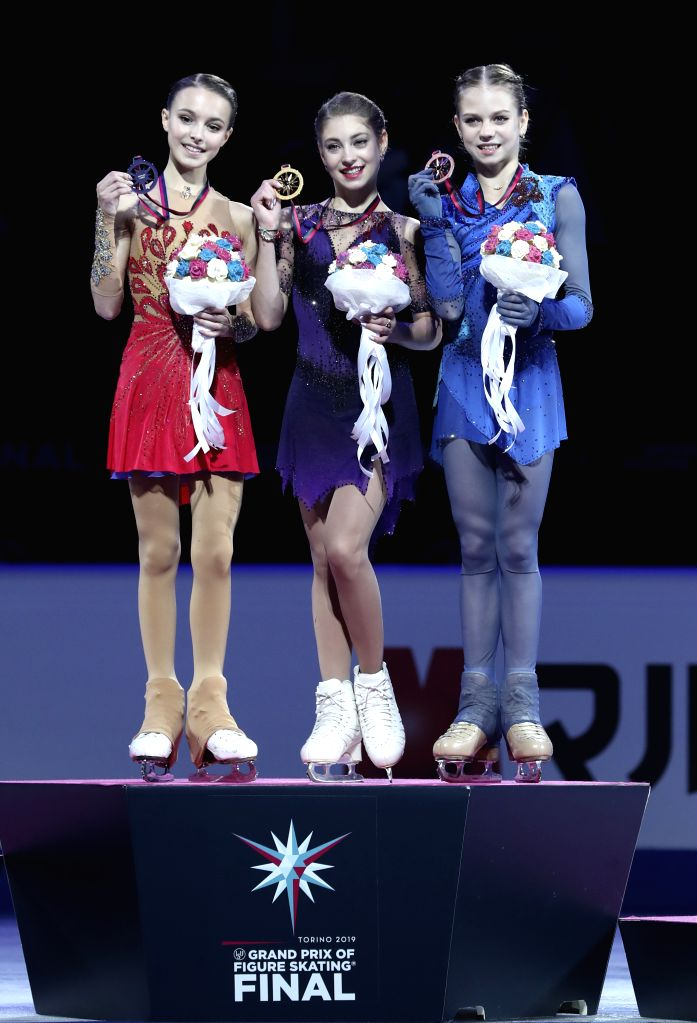 TURIN, Dec. 8, 2019 - Gold medalist Alena Kostornaia (C) of Russia, silver medalist Anna Shcherbakova (L) of Russia pose with bronze medalist Alexandra Trusova of Russia during the awarding ceremony ...