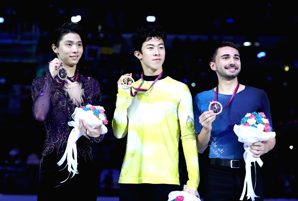 TURIN, Dec. 8, 2019 - Gold medalist Nathan Chen (C) of the United States, silver medalist Yuzuru Hanyu (L) of Japan pose with bronze medalist Kevin Aymoz of France during the awarding ceremony after ...