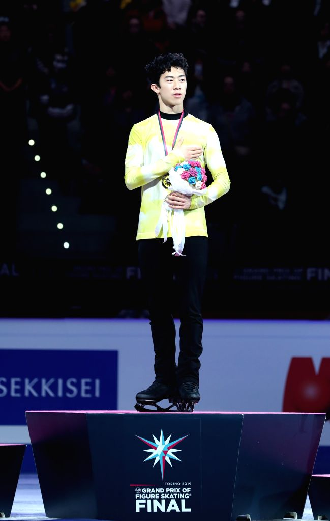 TURIN, Dec. 8, 2019 - Gold medalist Nathan Chen of the United States stands on the podium during the awarding ceremony after the men's free skating at the ISU Grand Prix of Figure Skating Final 2019 ...