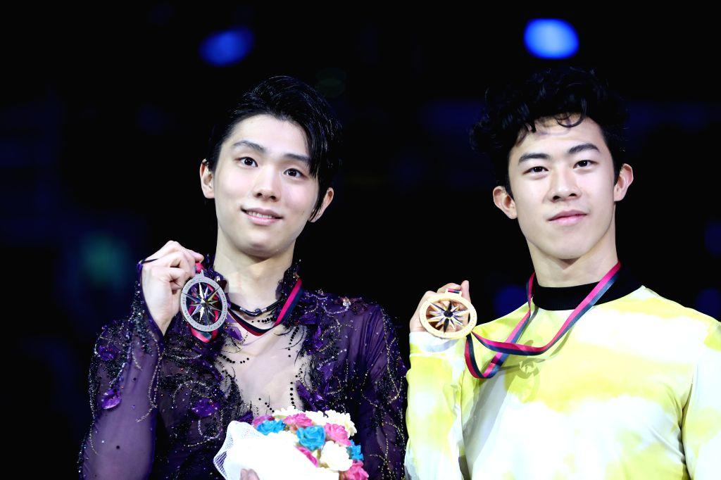 TURIN, Dec. 8, 2019 - Gold medalist Nathan Chen (R) of the United States poses with silver medalist Yuzuru Hanyu of Japan during the awarding ceremony after the men's free skating at the ISU Grand ...
