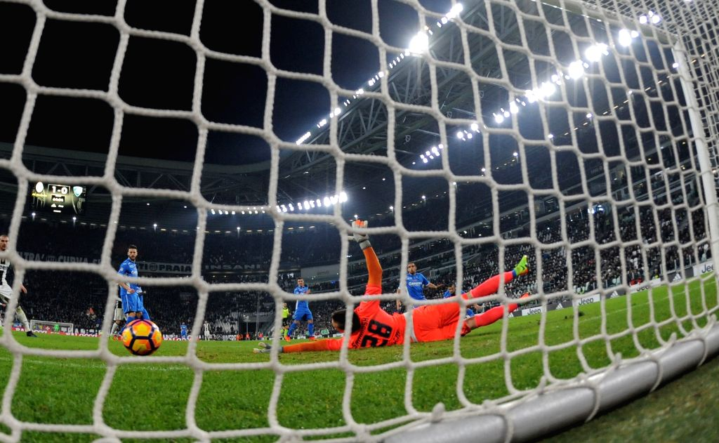 TURIN, Feb. 26, 2017 - Juventus' Alex Sandro scores during a Serie A soccer match between Juventus and Empoli, in Turin, Italy, Feb. 25, 2017. Juventus won 2-0.