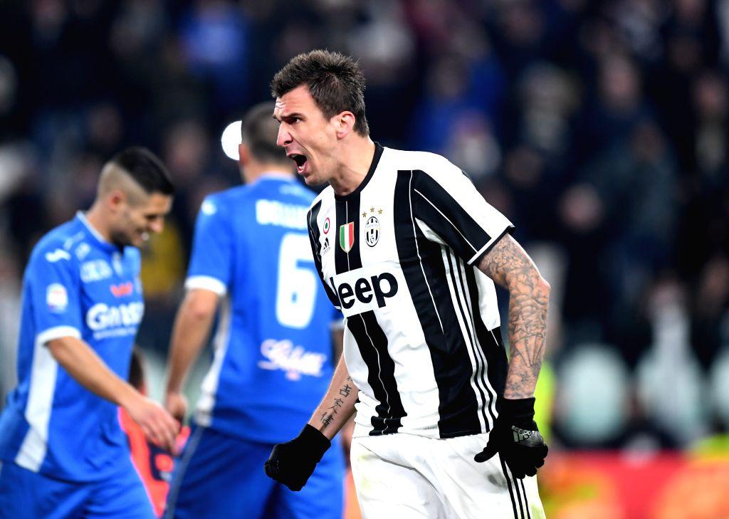 TURIN, Feb. 26, 2017 - Juventus' Mario Mandzukic celebrates after he scores during a Serie A soccer match between Juventus and Empoli, in Turin, Italy, Feb. 25, 2017. Juventus won 2-0.