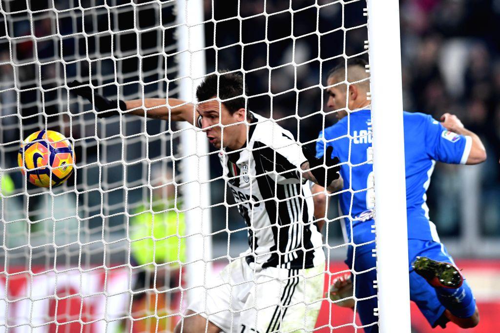 TURIN, Feb. 26, 2017 - Juventus' Mario Mandzukic scores during a Serie A soccer match between Juventus and Empoli, in Turin, Italy, Feb. 25, 2017. Juventus won 2-0.