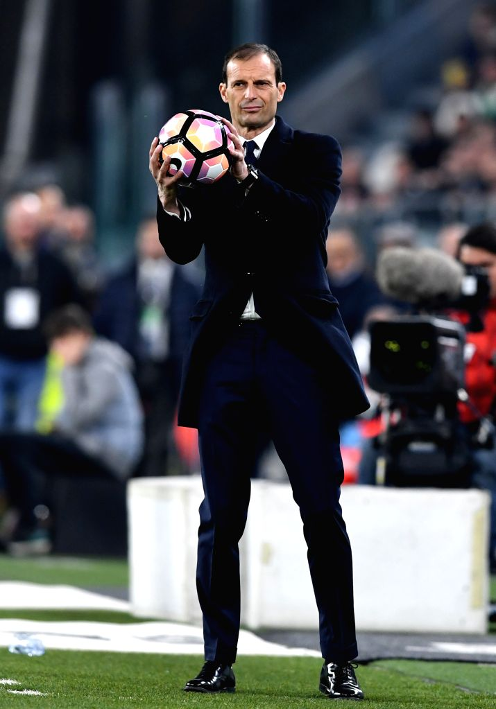 TURIN, March 11, 2017 - Massimiliano Allegri, head coach of Juventus holds the ball during the Italian Serie A soccer match between Juventus and AC Milan, in Turin, Italy, March 10, 2017. Juventus ...