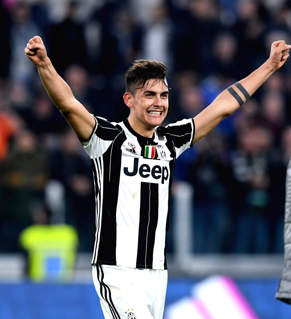TURIN, March 11, 2017 - Paulo Dybala of Juventus celebrates after winning the Italian Serie A soccer match between Juventus and AC Milan, in Turin, Italy, March 10, 2017. Juventus won 2-1.