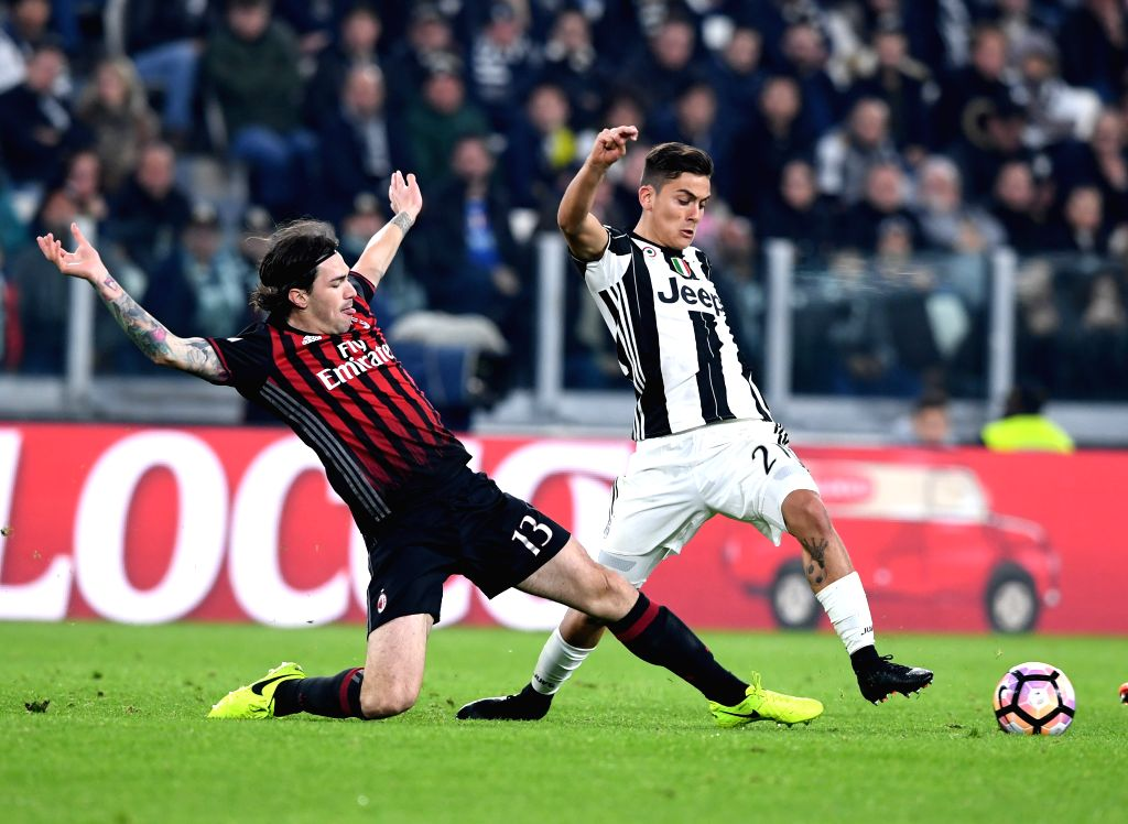 TURIN, March 11, 2017 - Paulo Dybala (R) of Juventus vies with Alessio Romagnoli of AC Milan during the Italian Serie A soccer match between Juventus and AC Milan, in Turin, Italy, March 10, 2017. ...