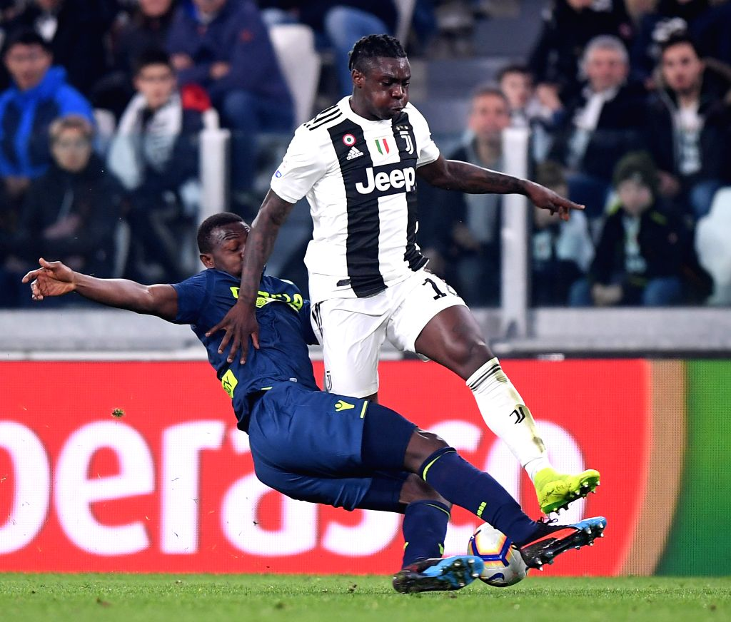 TURIN, March 9, 2019 - FC Juventus's Moise Kean (R) vies with Udinese's Nicholas Opoku during a Serie A soccer match between Juventus and Udinese in Turin, Italy, March 8, 2019. Juventus won 4-1.