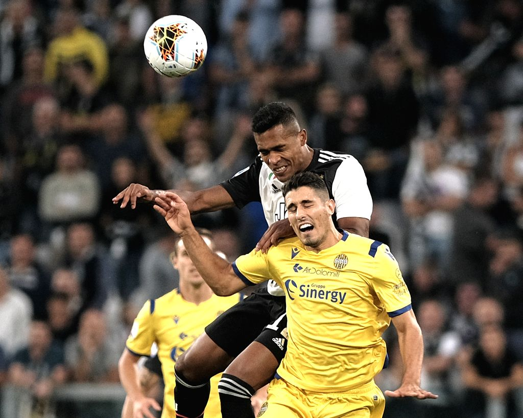 TURIN, Sept. 22, 2019 - Juventus' Alex Sandro (Top) vies with Verona's Davide Faraoni during a Serie A soccer match between Juventus and Verona in Turin, Italy, Sept. 21, 2019. Juventus won the match ...