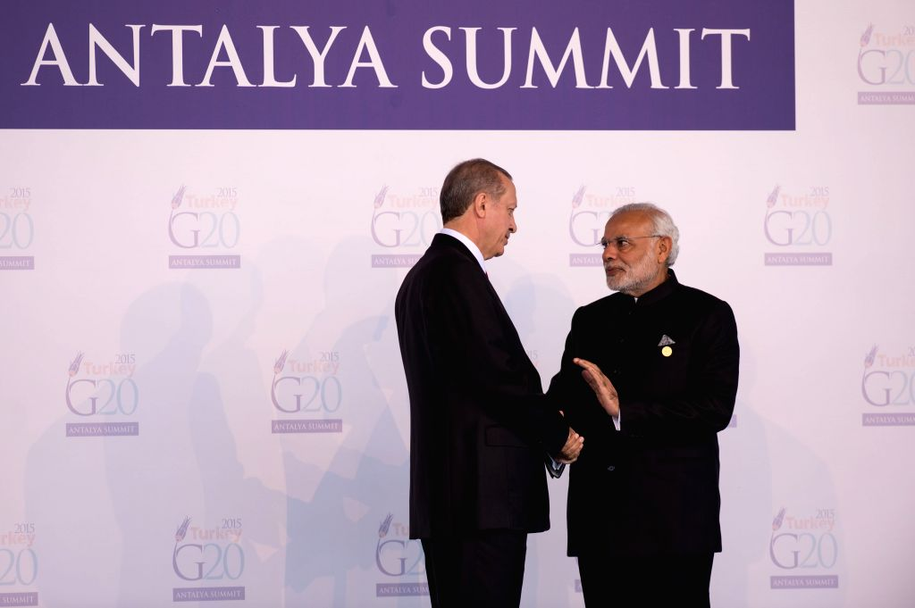 : Turkish President Recep Tayyip Erdogan (L) shakes hands with Indian Prime Minister Narendra Modi on the welcoming ceremony of G20 Summit held in Antalya, Turkey, ... - Narendra Modi