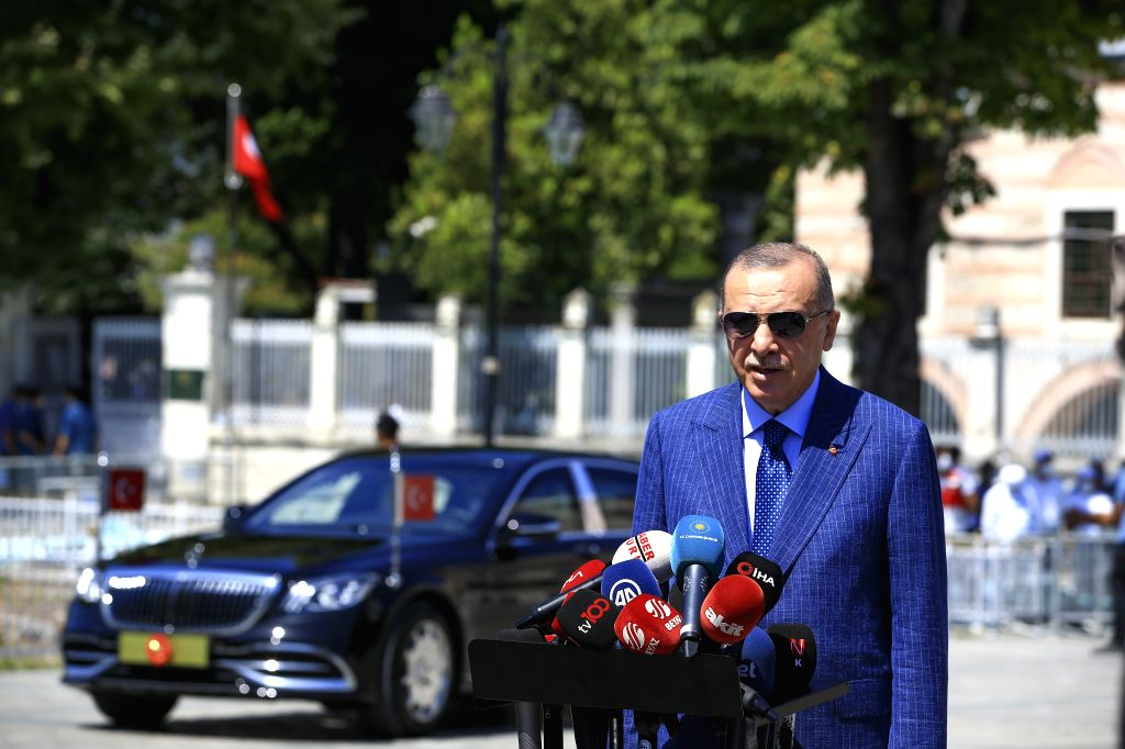 Turkish President Recep Tayyip Erdogan speaks to reporters after Friday prayers in Istanbul, Turkey, on Aug. 7, 2020. Turkish President Recep Tayyip Erdogan on ...