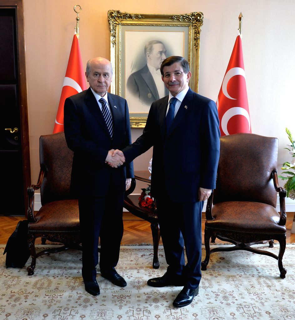 Turkish Prime Minister Ahmet Davutoglu (R)meet with the Nationalist Movement Party (MHP) leader Devlet Bahceli in Ankara, Turkey, on  Aug. 17, 2015. There is no ... - Ahmet Davutoglu