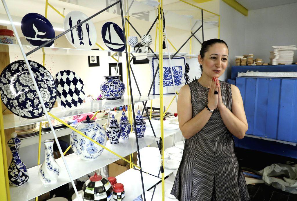 Turkish tile and ceramic artist Ozlem Varol introduces her works in a studio in Istanbul, Turkey, on June 24, 2020. Ozlem Varol has been offering a new way of ... - Ozlem Varol