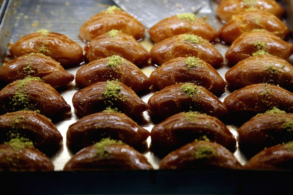 Turkish traditional desserts are displayed in Ankara, Turkey, July 30, 2020. It is a Turkish tradition to eat dessert during Eid al-Adha festival, which lasts from ...