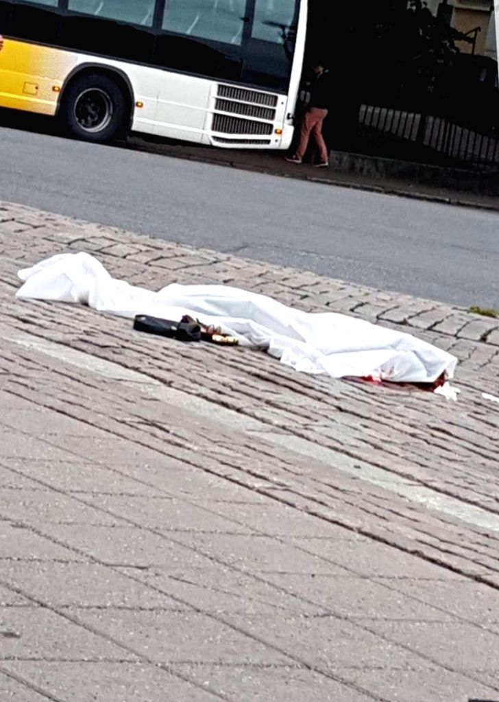 TURKU (FINLAND), Aug. 18, 2017 A victim is seen lying on the ground covered with a white sheet following stabbing attacks in Turku, southwestern Finland, on Aug. 18, 2017. Several people ...