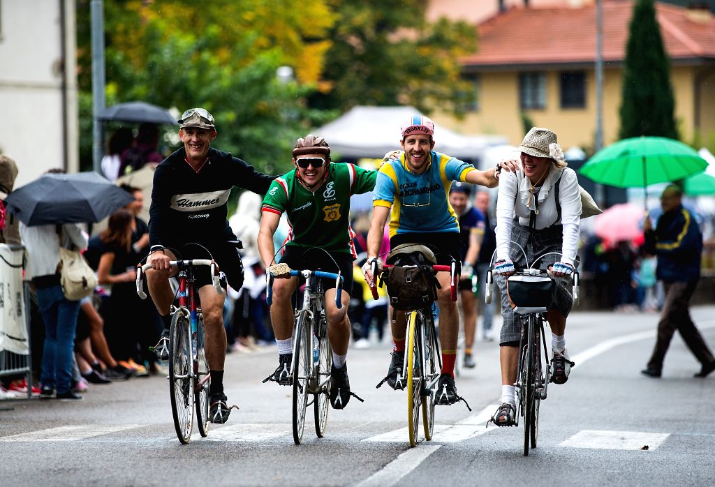 """TUSCANY, Oct. 2, 2017 - Cyclists ride their vintage bikes towards the finish line during the """"Eroica"""" cycling event for old bikes in the Chianti area of Tuscany, Italy, on Oct. 1, 2017. ..."""