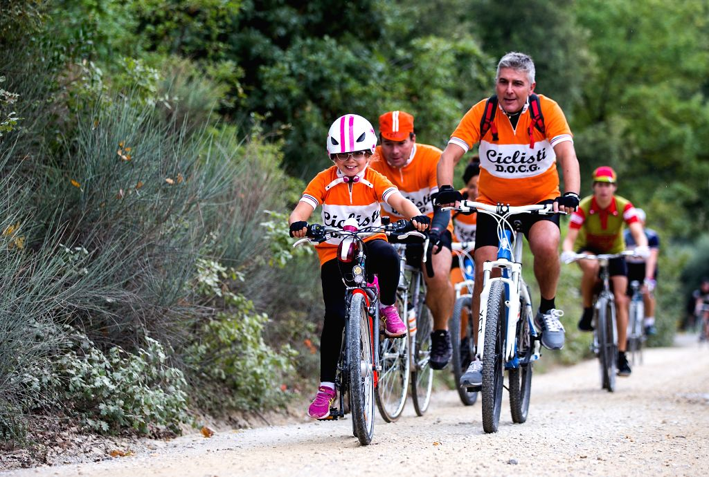 """TUSCANY, Oct. 2, 2017 - Cyclists ride their vintage bikes during the """"Eroica"""" cycling event for old bikes in the Chianti area of Tuscany, Italy, on Oct. 1, 2017. More than 7,000 cyclists, ..."""