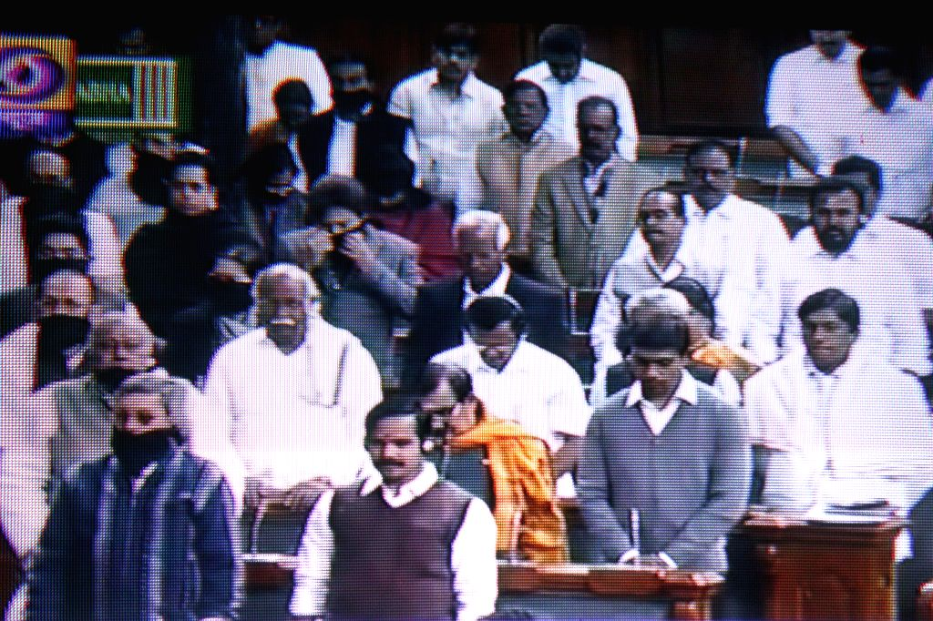 TV GRAB: Parliamentarians observe silence in Lok Sabha to condemn Tuesday's attack on the Army Public School in Peshawar, Pakistan, that claimed 104 lives mostly those of children, in New Delhi, on ..