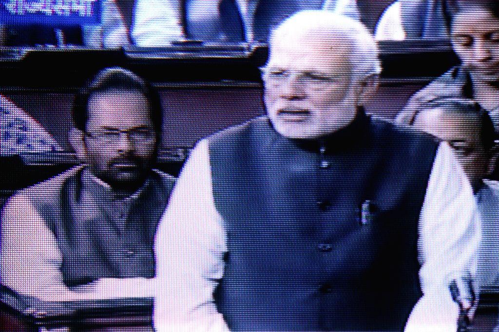 TV GRAB: Prime Minister Narendra Modi addresses at the Rajya Sabha in New Delhi on Dec 4, 2014. - Narendra Modi
