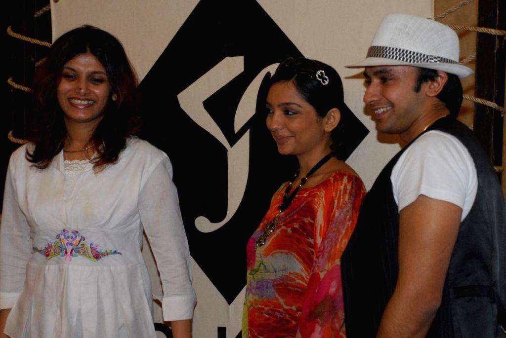 TV star June Malya with promising designers Arjun Agarwal  and Sanchita Julkha  at a function, official Promo film launched programme of Kolkata Fashion week In Kolkata on Monday 30th Mar 09.