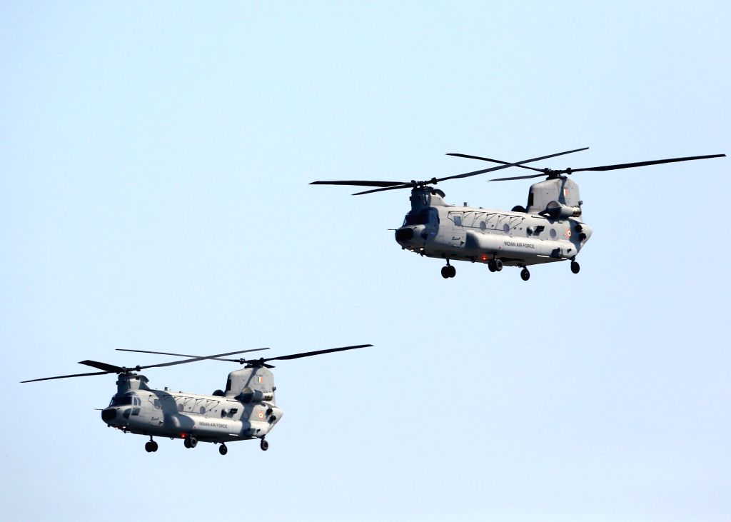 Twin-rotor blade Chinook choppers participate in flypast during the 87th anniversary celebrations of the Indian Air Force (IAF) at Hindon Air Force Station in Ghaziabad, on Oct 8, 2019.