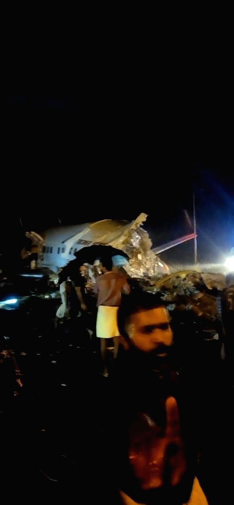 Two dead as AirIndia Express skids off Kozhikode airport, several injured.