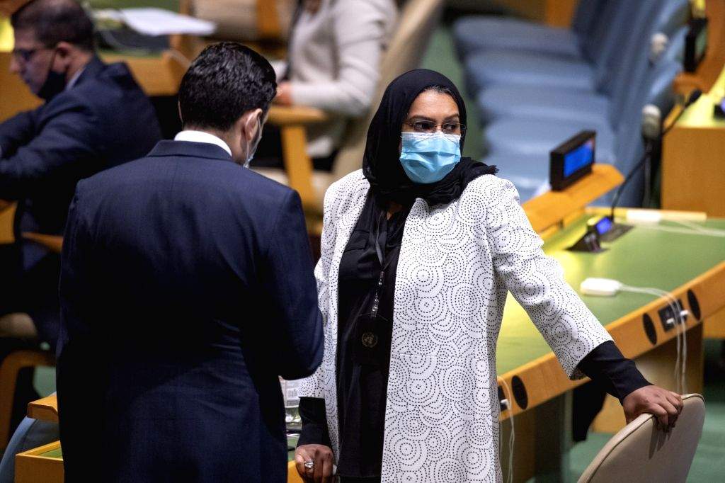 Two deputies attend the 64th plenary meeting of the 74th session of the UN General Assembly at the UN headquarters in New York, Sept. 11, 2020. The General ...