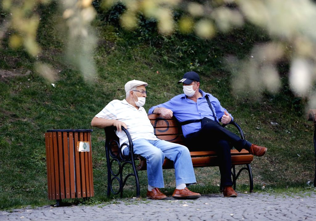 Two men wearing face masks sit on a bench in a park in Ankara, Turkey, on Aug. 28, 2020. Turkey confirmed 1,517 new COVID-19 cases on Friday, raising the total ... - Fahrettin Koca