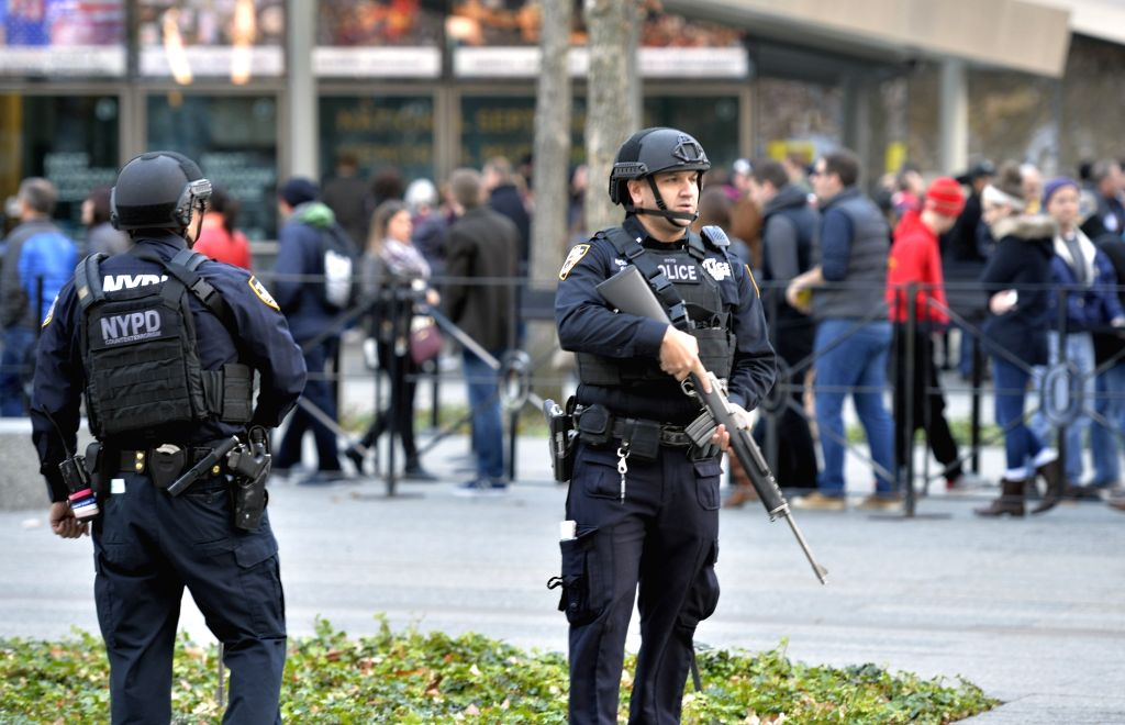 Two NYPD armed police officers stand guard near the 9/11 Memorial Museum in Manhattan, New York City, the United States, Nov. 14, 2015. The NYPD Counterterrorism ...