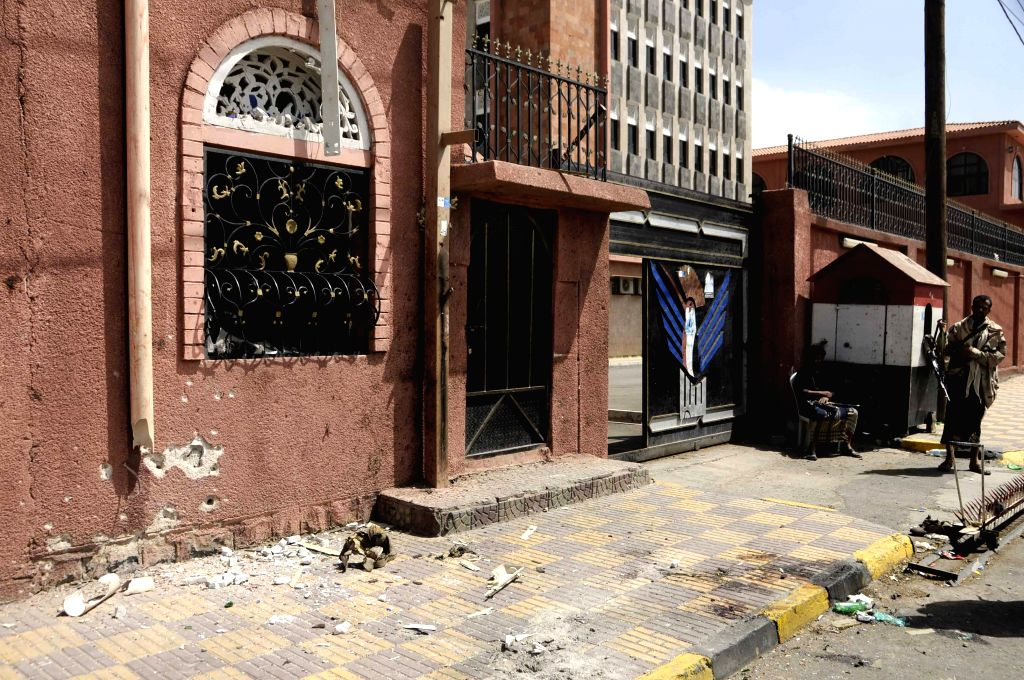 Two soldiers stay outside the Saba news agency in Sanaa, Yemen, on June 25, 2015. An explosive device went off outside Yemen's state-run Saba news agency that is ...
