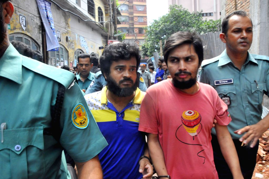 Two suspects of a murder case of Bangladeshi bloggers arrive to a court for appeal in Dhaka, capital of Bangladesh, Aug. 19, 2015. Three suspects including a British ... - Abhijit Roy