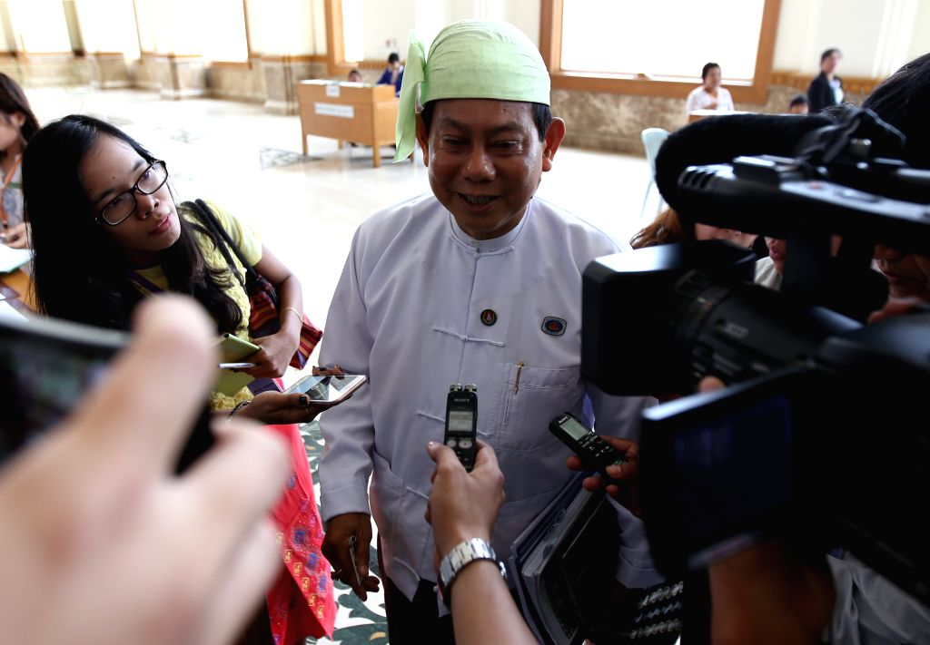 U Htay Oo (C), vice Chairman cum Chairman of the Union Solidarity and Development Party (USDP), speaks to the media as he arrives at the parliament to attend ...