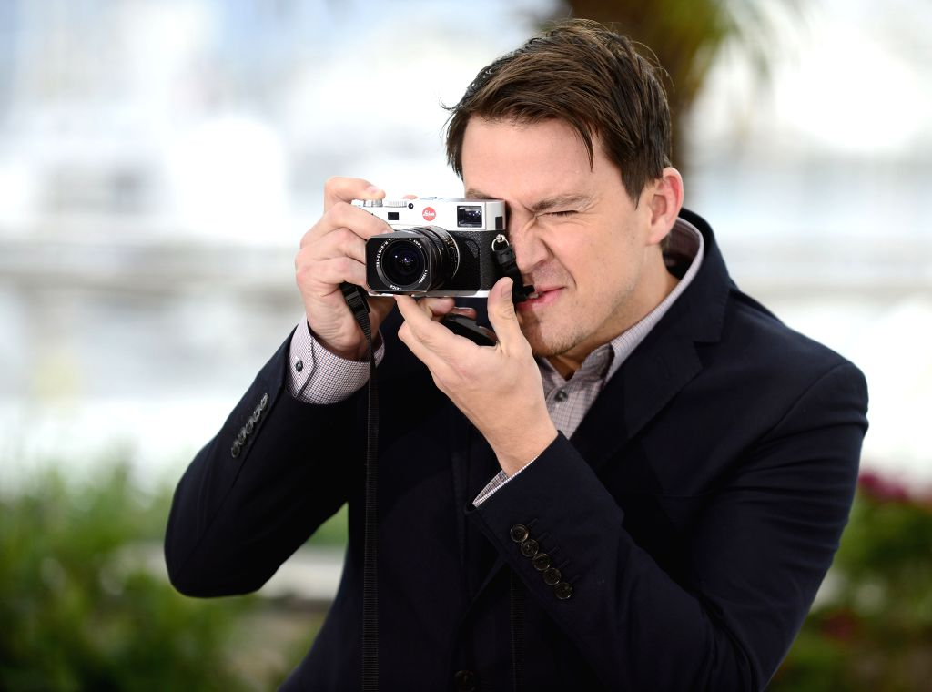 : U.S. actor Channing Tatum takes photographs as he poses during the photocall for 'Foxcatcher' at the 67th Cannes Film Festival in Cannes, France, May 19, ...