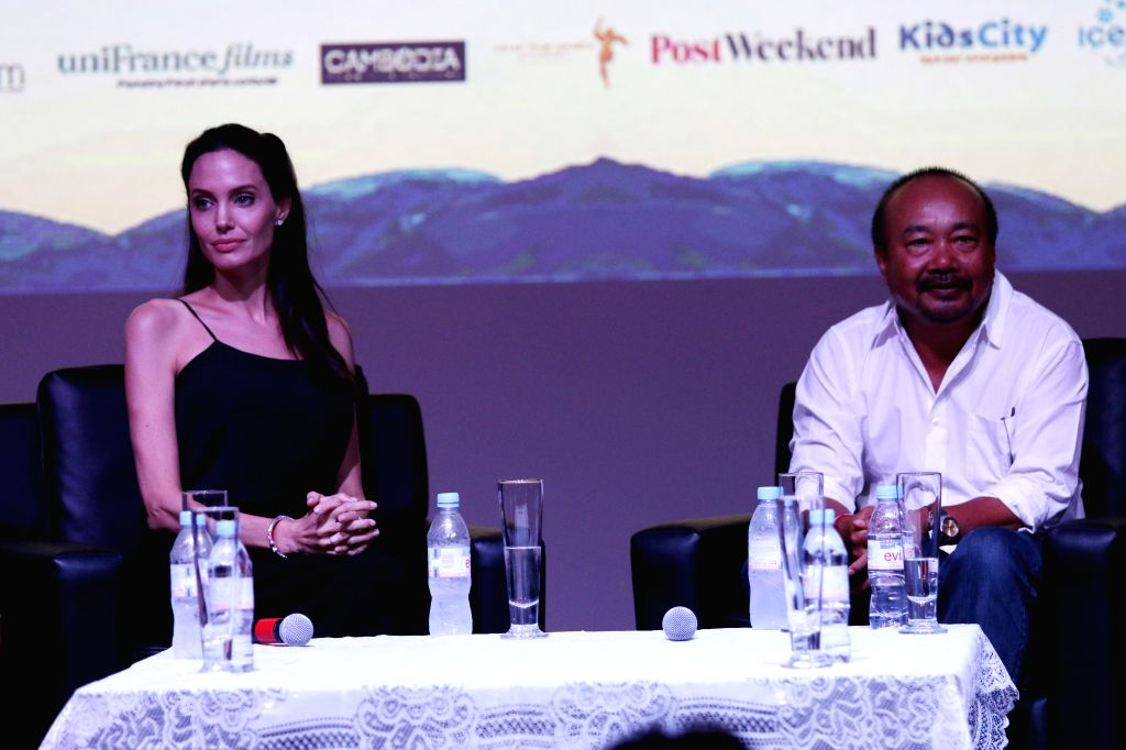 U.S. actress and filmmaker Angelina Jolie Pitt (L) and Oscar-nominated Cambodian filmmaker Rithy Panh attend a conversation on the new generation of Cambodian ...