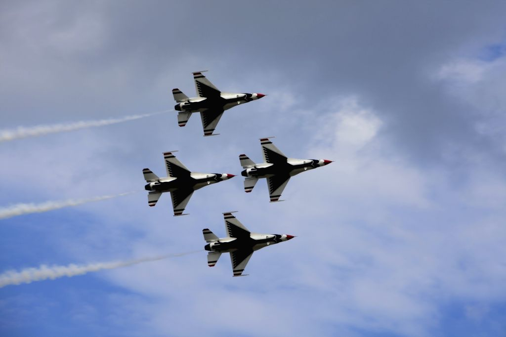 U.S. Air Force Thunderbirds Demonstration Squadron performs aerobatics during an air show celebrating the 70th birthday of U.S. Air Force at Joint Base ...
