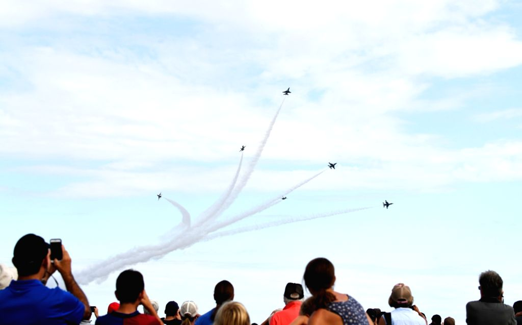 U.S. Air Force Thunderbirds perform aerobatics during an air show celebrating the 70th birthday of U.S. Air Force at Joint Base Andrews outside ...