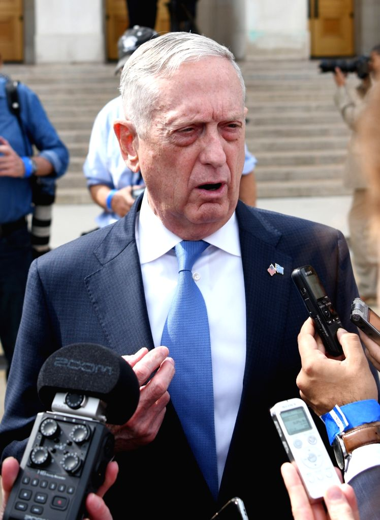 :U.S. Defense Secretary James Mattis talks to journalists while waiting for Greek Defense Minister Panos Kammenos at the Pentagon in Virginia, the United ...