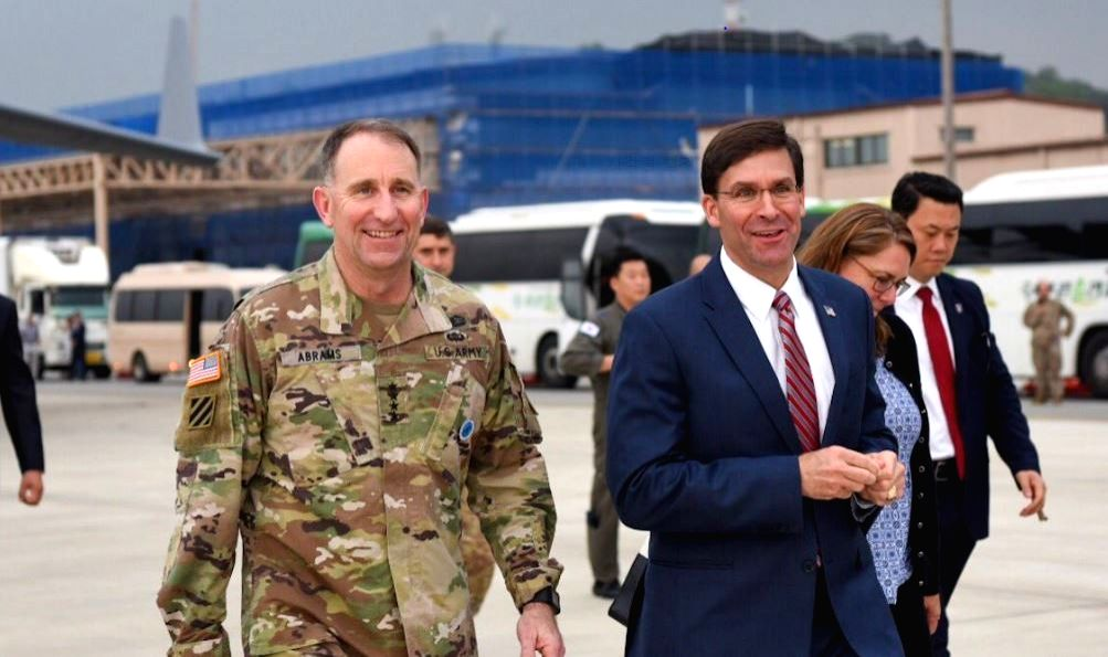 U.S. Defense Secretary Mark Esper (R), welcomed by Gen. Robert Abrams, commander of U.S. Forces Korea, arrives at U.S. Osan Air Base in Pyeongtaek, south of Seoul, on Aug. 8, 2019, in this ...