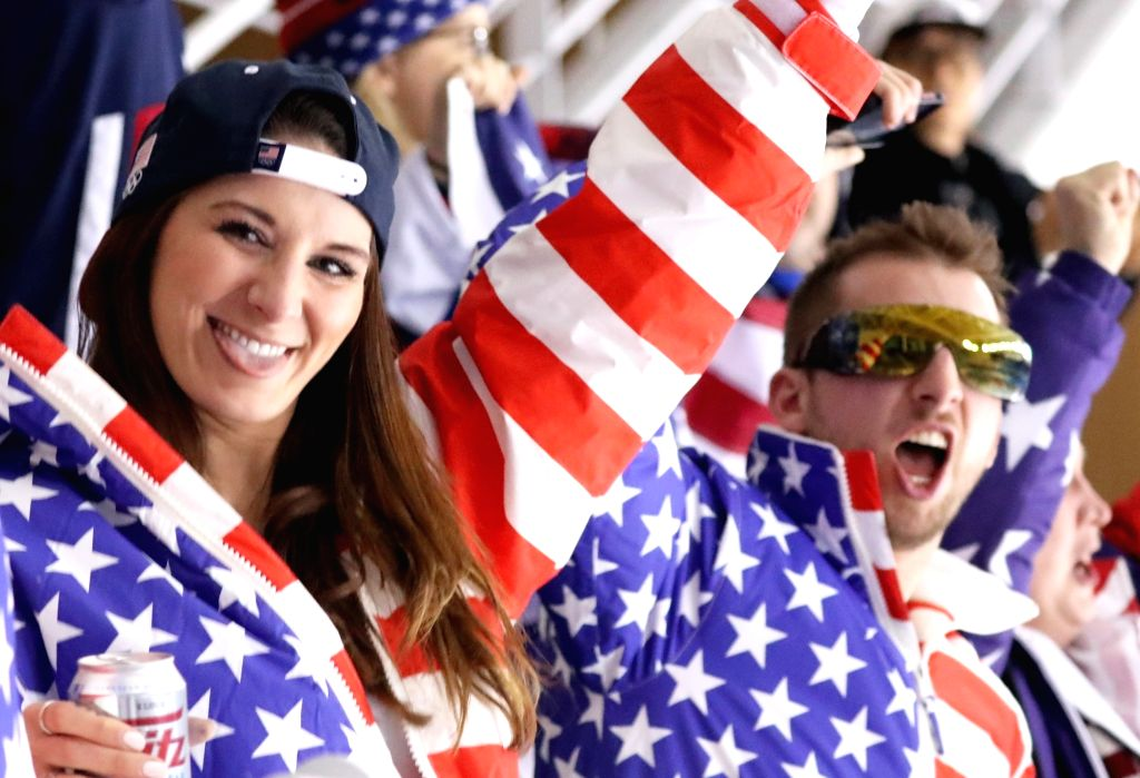 U.S. fans cheer for American athletes in an event between Olympic Athletes from Russia and the United States at the PyeongChang Winter Olympics on Feb. 13, 2018, at Kwandong Hockey Centre ...