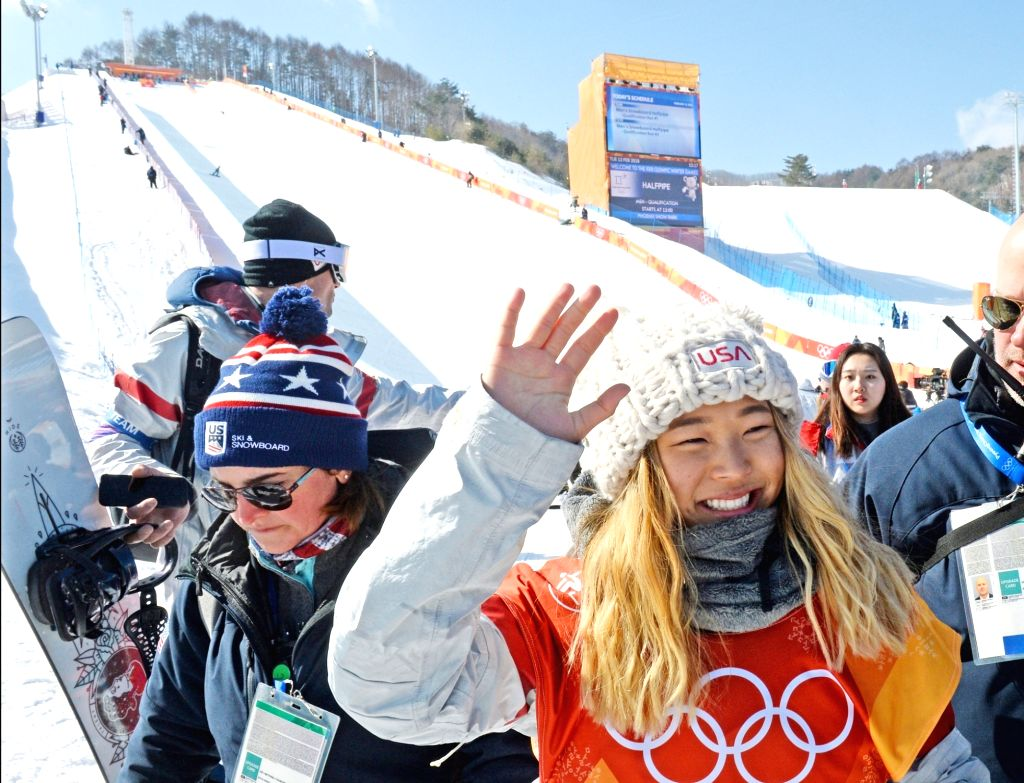 U.S. freestyle snowboarder Chloe Kim waves after winning the women's halfpipe final of the PyeongChang Winter Olympics at Phoenix Snow Park in Pyeongchang, about 180 kilometers east of ...