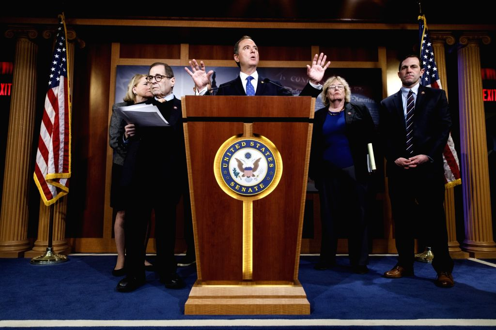 U.S. House Intelligence Committee Chairman Adam Schiff (C) speaks at a press conference during the Senate impeachment trial on Capitol Hill in Washington D.C., ...