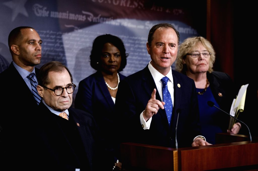 U.S. House Intelligence Committee Chairman Adam Schiff (2nd R) speaks at a press conference during the Senate impeachment trial on Capitol Hill in Washington ...