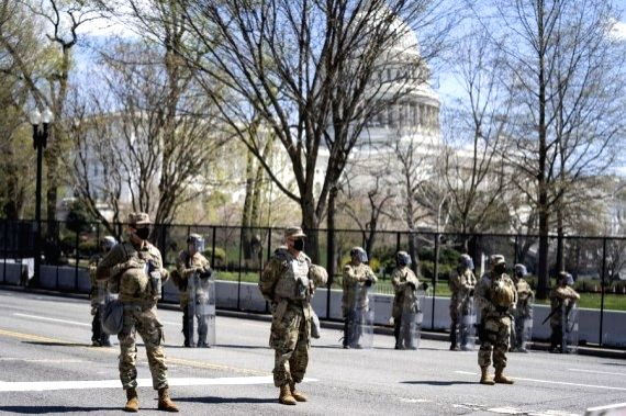 U.S. National Guard members stand guard in front of the U.S. Capitol building in Washington, D.C., the United States, on April , 2021.