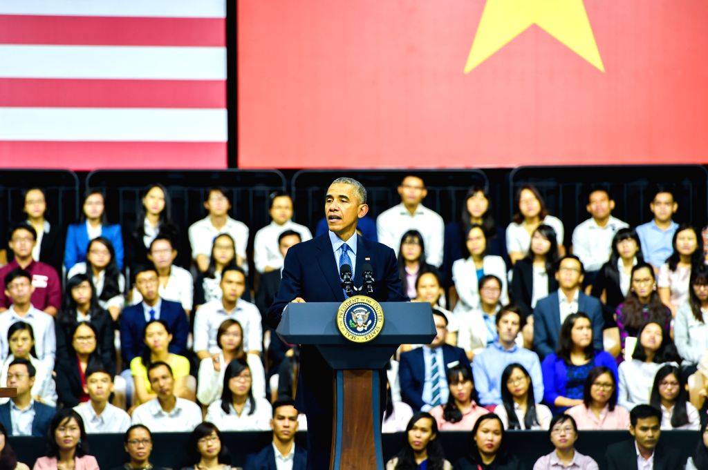 U.S. President Barack Obama (C) speaks as he meets with members of the Young Southeast Asian Leaders Initiative in Ho Chi Minh City's Gem Center, Vietnam, ...