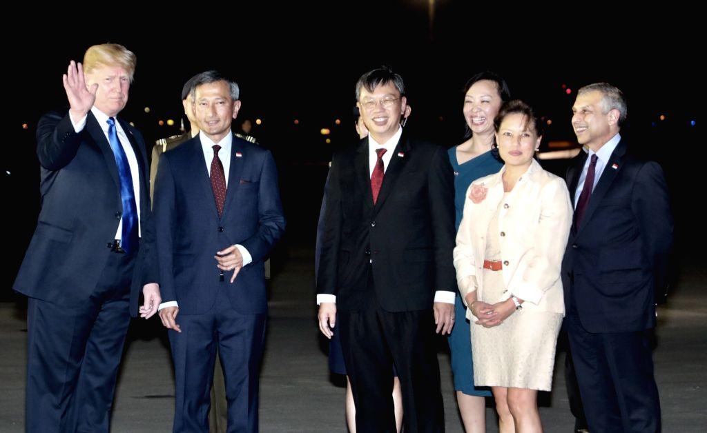 :U.S. President Donald Trump (1st L) arrives in Singapore on June 10, 2018. .