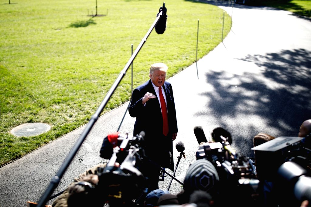 :U.S. President Donald Trump speaks to reporters before departing from the White House in Washington D.C., the United States, on Oct. 22, 2018. Donald Trump ...