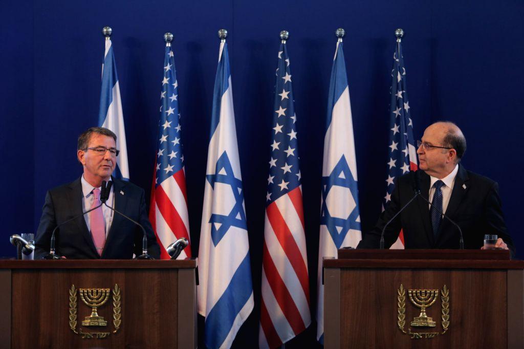 U.S. Secretary of Defense Ashton Carter (L) and Israeli Defense Minister Moshe Ya'alon hold a joint press conference at the Kirya base in Tel Aviv, Israel, on ... - Moshe Y